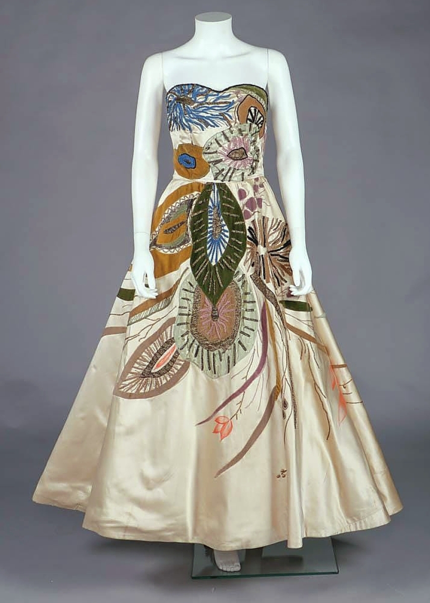 Among three gowns by Emilio Schuberth, all coming from a Rome collection, was this circa 1950s cream silk satin strapless example with aquatic flora design. All of the examples from this collection had been exhibited and published. This one took $5,000.