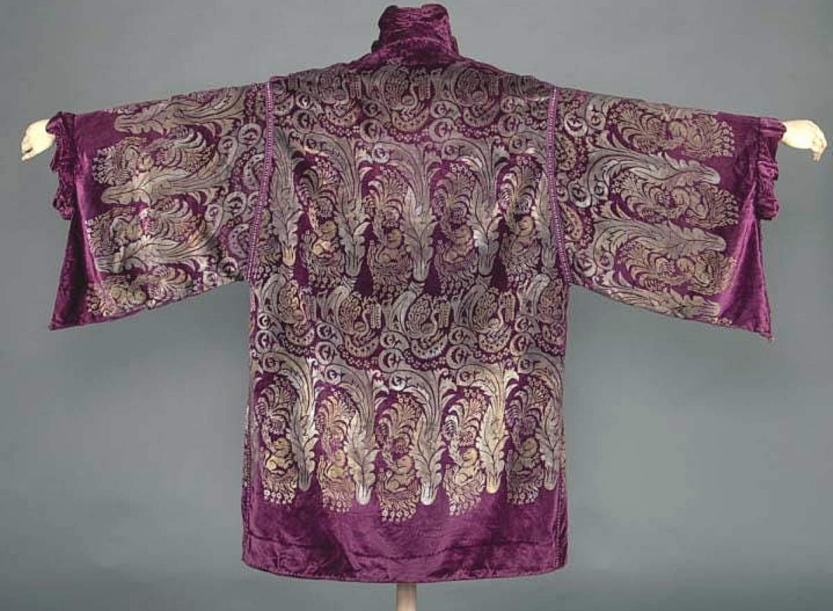 """Descending through three generations in the consignor's family was this velvet evening coat with stenciled silk designs by Maria Monaci Gallenga. It sold for $8,125, the second highest result in the sale. """"Gallenga and Fortuny, those were the two big names that did these sort of gold stenciled evening wear on velvet,"""" Ricklis said. """"The patterns Gallenga used were very rococo and Renaissance style. Because the material was so high quality, they really stood the test of time."""""""