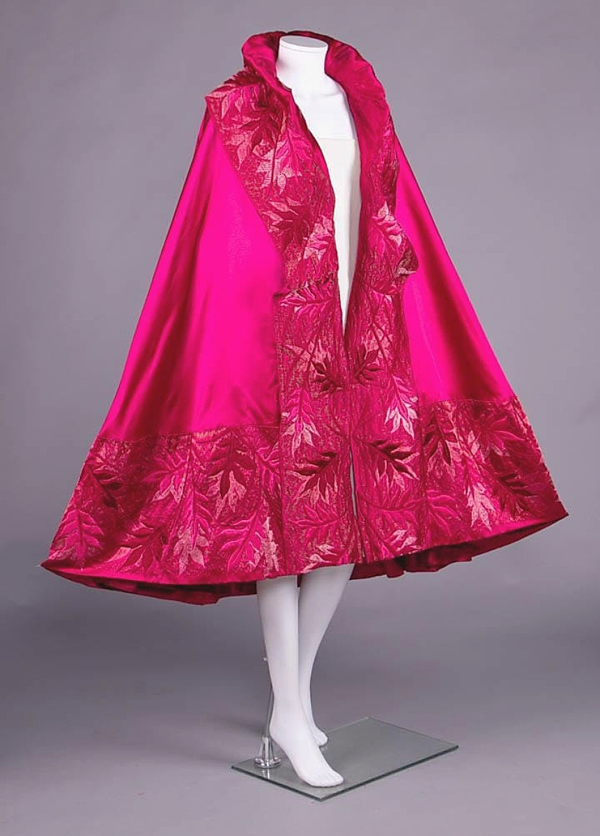 """The sale's top lot at $20,400 was among the earliest examples from Gabrielle """"Coco"""" Chanel that Augusta Auction had ever sold. The fuchsia silk satin evening cape was created circa 1923 during Chanel's relationship with the exiled Russian royal Grand Duke Dmitri Pavlovich. Her relationship with Pavlovich would lead to a collaboration with the Grand Duchess Maria Pavlovna, resulting in the Kitmir line, which saw traditional Slavic embroidery techniques embellished on Chanel's modern cuts."""