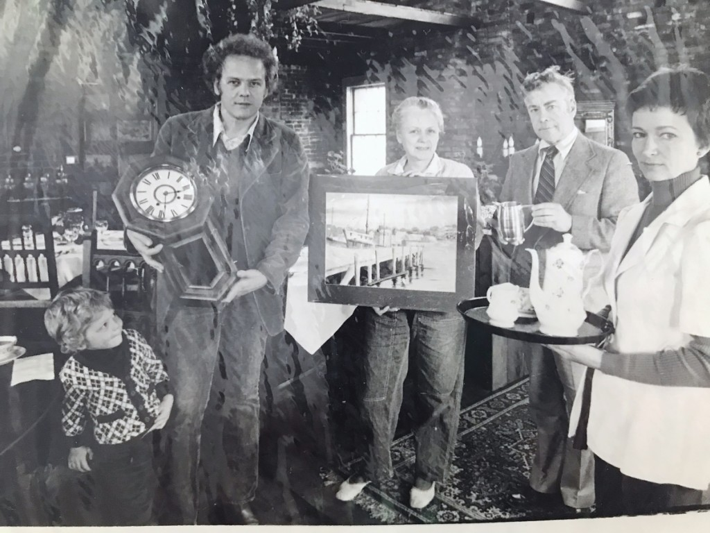 From left to right, Nathaniel Snow, Chris Snow, unidentified person, Swift Barnes and unidentified person, in a photograph taken at an auction in 1974.