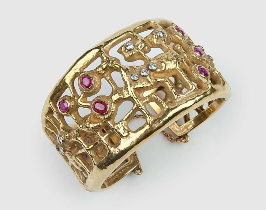 Italian painter Afro Basaldella designed this gold bangle set with rubies and diamonds. It was made in the Rome workshop of Diderico Gherardi for Mario Masenza around 1960. Didier, Ltd., London.