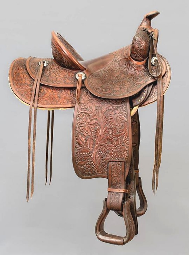 President Ronald Reagan gave this saddle to Buck Wicall, a friend of his who owned a tack and feed store near his ranch. The tooled leather saddle made by Edward H. Bohlin went out at $41,300.