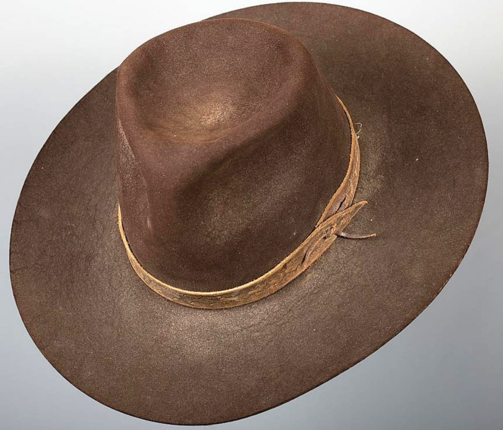 John Wayne's beaver hat worn in Cahill U.S. Marshal sold for $29,500. It was given to writer Boyd Magers by Luster Bayless, Wayne's personal costumer.