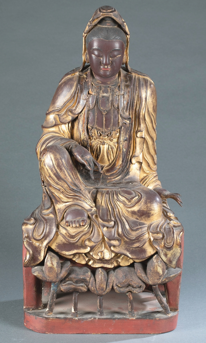 A carved lacquer and wood guanyin, Ming dynasty (1368-1644) was pushed to $63,500 from its $4/6,000 estimate. The 21½-inch-high figure came from the estate of a southern Maryland collector/dealer and was on a red lacquer wood stand.