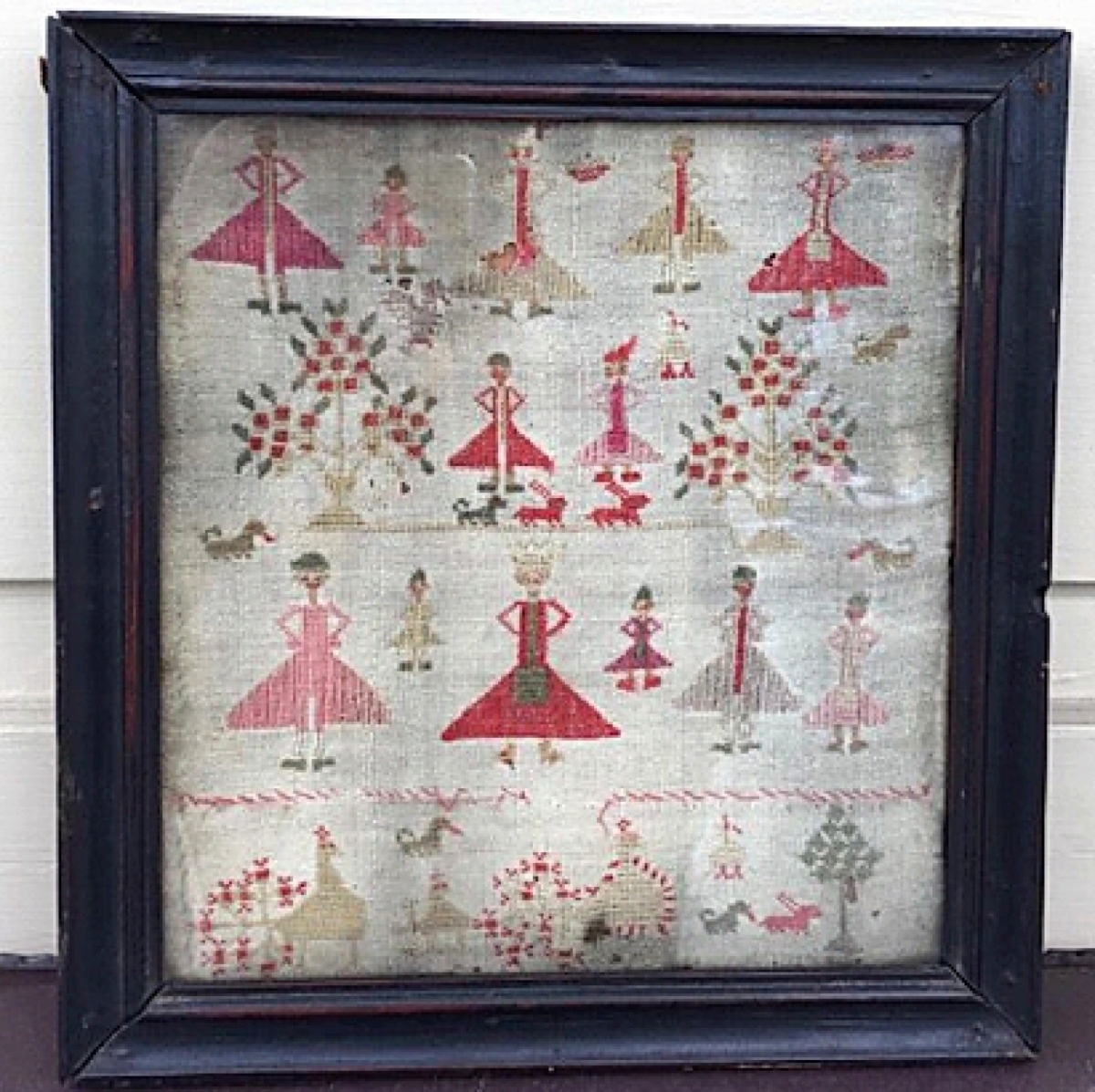 There were few samplers in the sale but this example, unattributed but dating to the early 1800s, depicted girls in red dresses with animals and trees on linen. Barb Lemme and Ginny Larsen, Sign of the Whale Antiques, Glen Ellyn, Ill., sold it along with 11 other items.