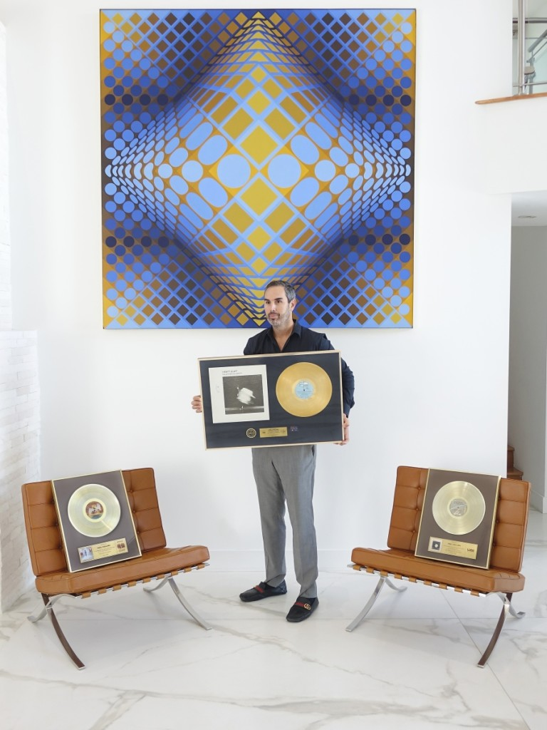 Kodner Galleries president and auctioneer Russ Kodner with the three gold records awarded to Phil Collins, which were being sold by his ex-wife, Orianne Collins.