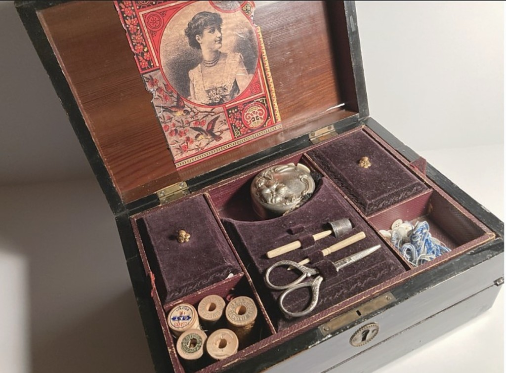 Victorian women were good multitaskers! Templeton Trading Post, La Grange Park, Ill., sold this dual-purpose black lacquered sewing box and writing desk that featured a lift-out tray with sewing tools and writing implements.
