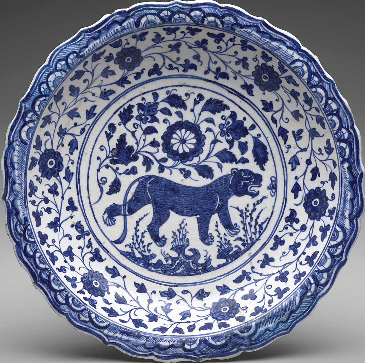 Dish, Persian, second half of the Fifteenth Century. Stonepaste painted in blue on white slip under transparent glaze. The Hossein Afshar Collection at the Museum of Fine Arts, Houston.