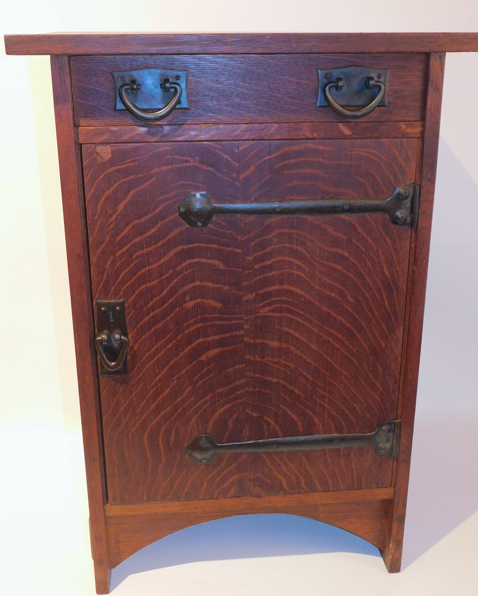 A New Jersey collector paid $6,222 for this Gustav Stickley smoker's stand that was designed by Harvey Ellis around 1904. Like many of the other Arts and Crafts pieces, it was from a Martha's Vineyard estate. ($ ,000)