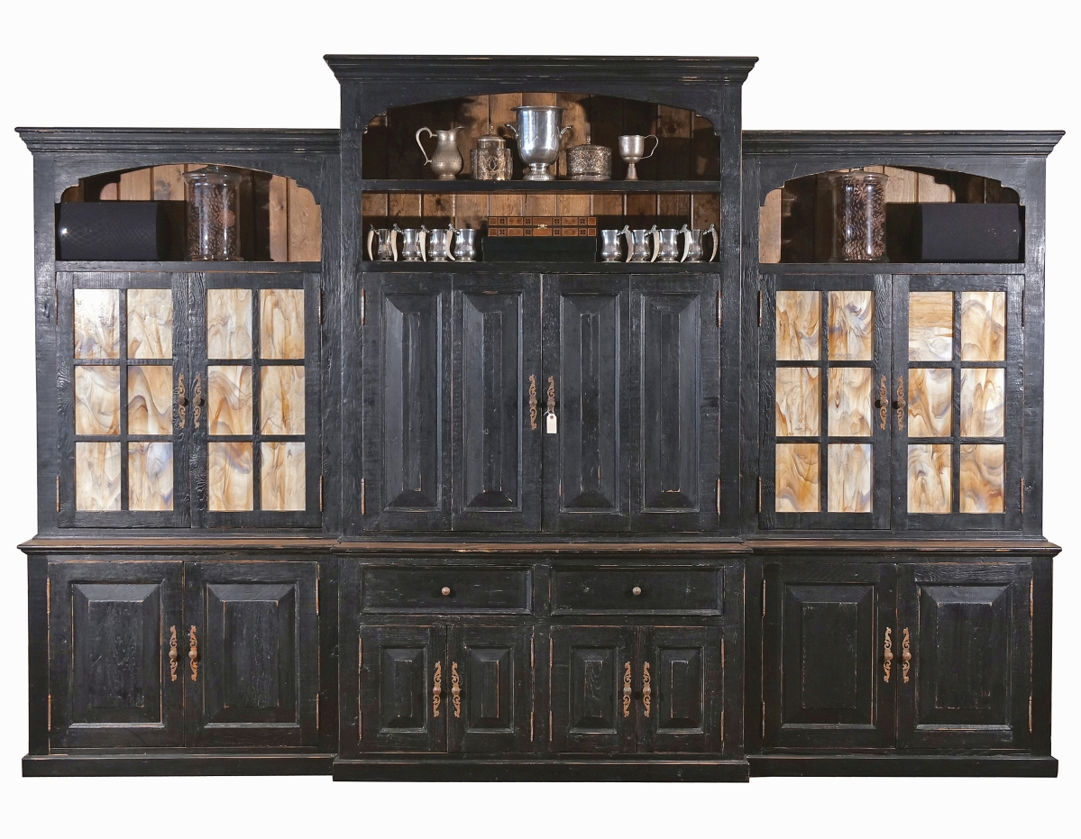 Men's fashion guru Joseph Abboud is a local celebrity as chief executive officer of Herringbone Creative, which is based in Bedford. This Country Willow library cabinet, a bespoke piece built for Abboud's office from reclaimed barn wood stained, distressed and rubbed with beeswax, more than tripled its high estimate to finish at $19,050. Luckily for the purchaser, the 102-by-145-by-24-inch unit could be broken down into six sections for moving.