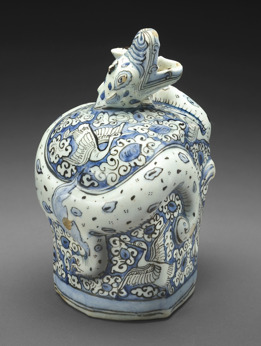 Base of a water pipe (qalyan), Persian, early Seventeenth Century. Stonepaste painted in blue and black under transparent glaze; molded. The Hossein Afshar Collection at the Museum of Fine Arts, Houston.