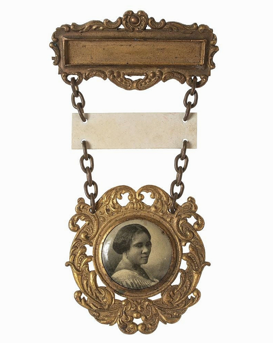 A number of items pertaining to Madam CJ Walker, said to be America's first self-made female millionaire, came from the collection of Eric Majette Jr. This badge, likely made for a sales representative of the Madam CJ Walker Company for use at a convention, went on to bring $9,375.