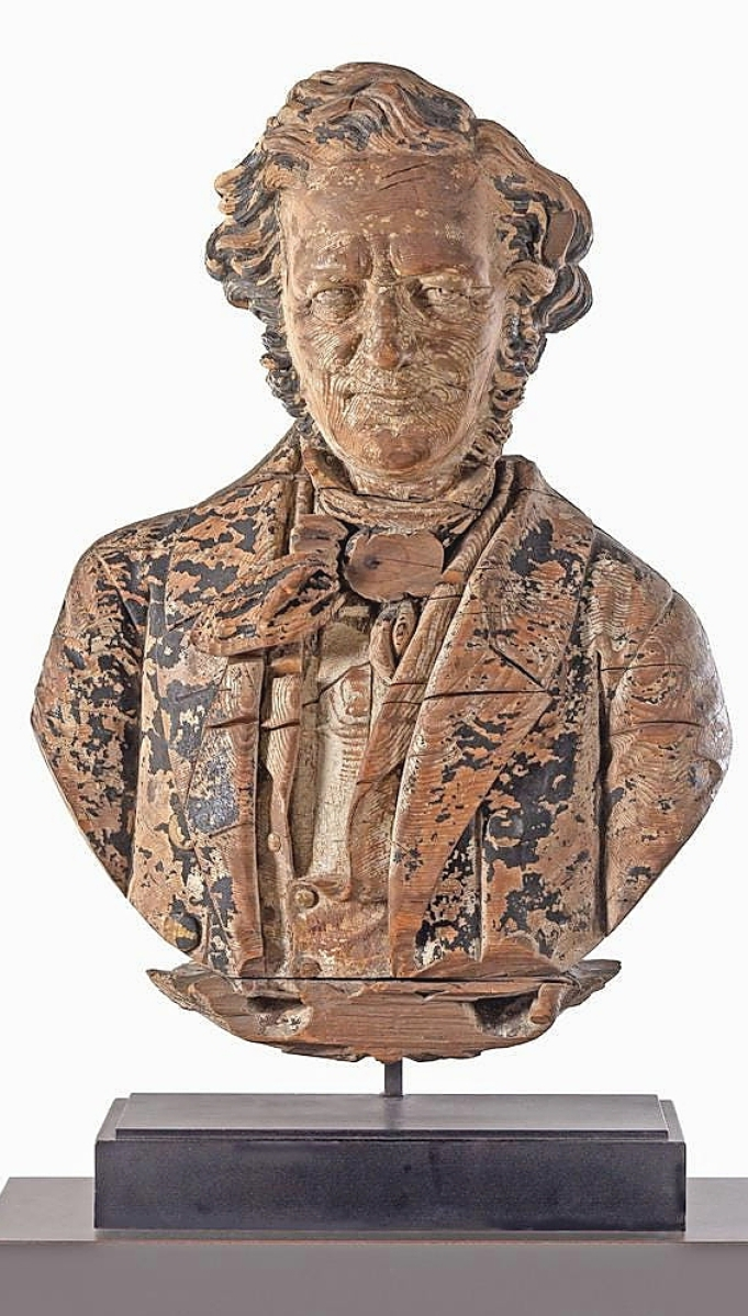"""Paul and Judy Bentley bought this pine portrait bust of Daniel Webster at the 2019 Sotheby's sale from the collection of Stephen and Petra Levin. It sold slightly higher this time at $15,000. Ben Fisher said, """"Sometimes you take things away from New York and you get a different pool of buyers."""""""