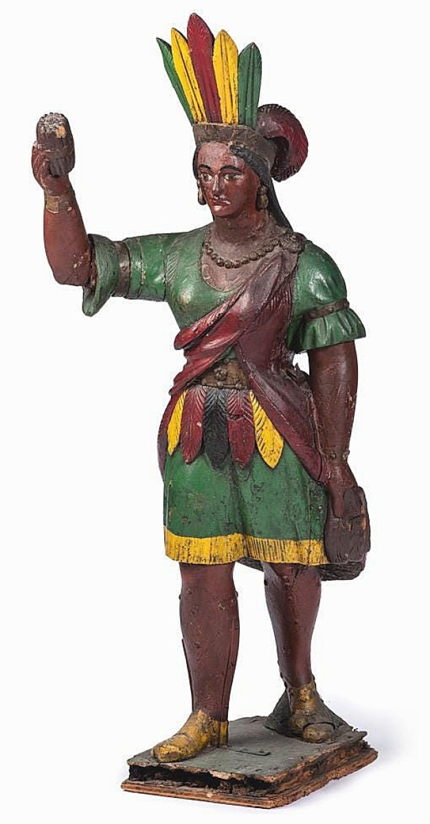 At 58 inches high, this carved and polychromed painted pine Native American maiden cigar store figure would sell for quadruple estimate at $20,000. The firm said it was made in the manner of New York carver Samuel Robb, circa 1900. It came out of a Maryland interior designed by Robert Metzger.