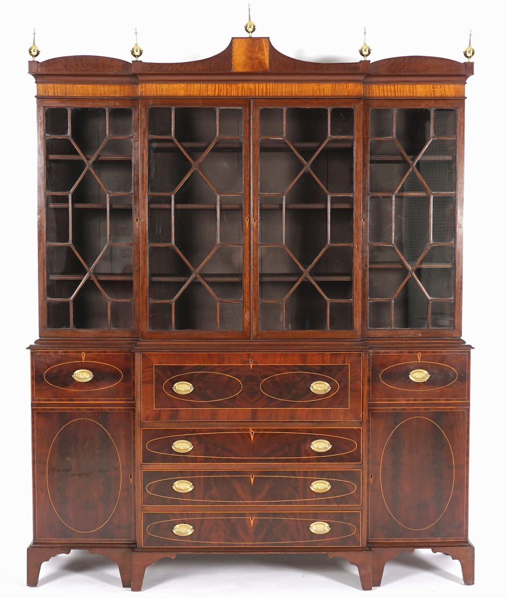The American Federal inlaid secretary bookcase doubled its high estimate to finish at $10,030. Possibly of Pennsylvania origin, the circa 1800 breakfront featured a mahogany case with fruit wood string inlay.
