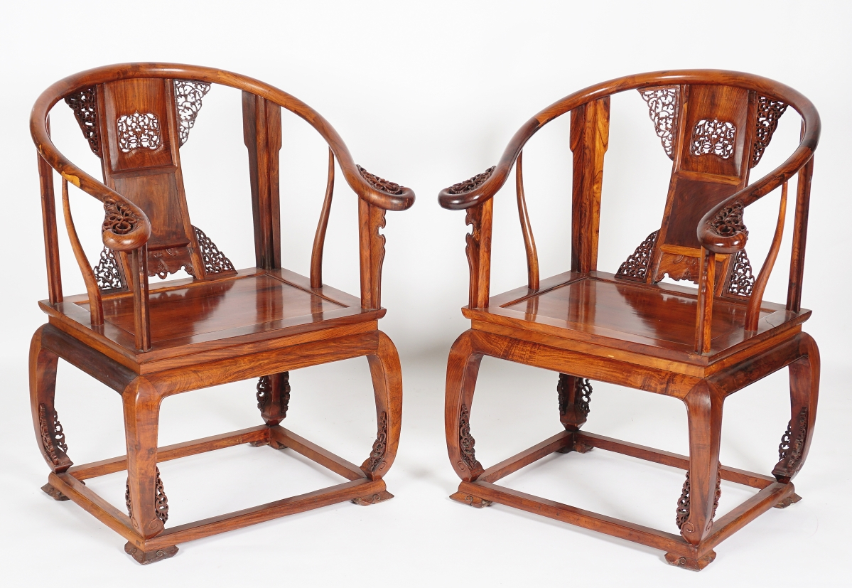 A pair Chinese imperial huanghuali horseshoe back armchairs sold for $18,000.