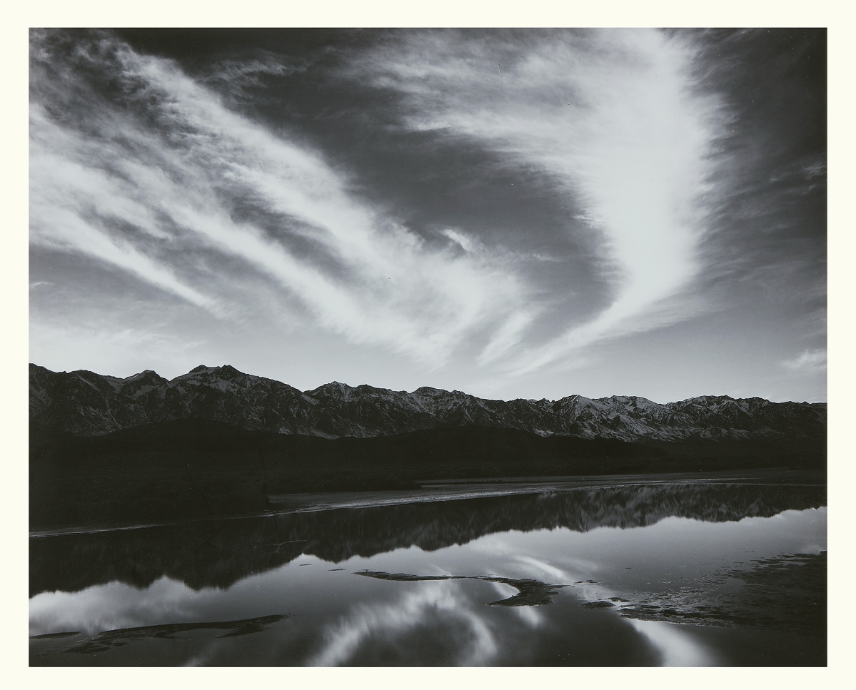"""A circa 1962 gelatin silver print by Ansel Adams (1902-1984), """"Evening Clouds, East Side of the Sierra Nevada, California,"""" once in the collection of Polaroid Corporation co-founder Dr Edwin H. Land, was bid to $10,710."""