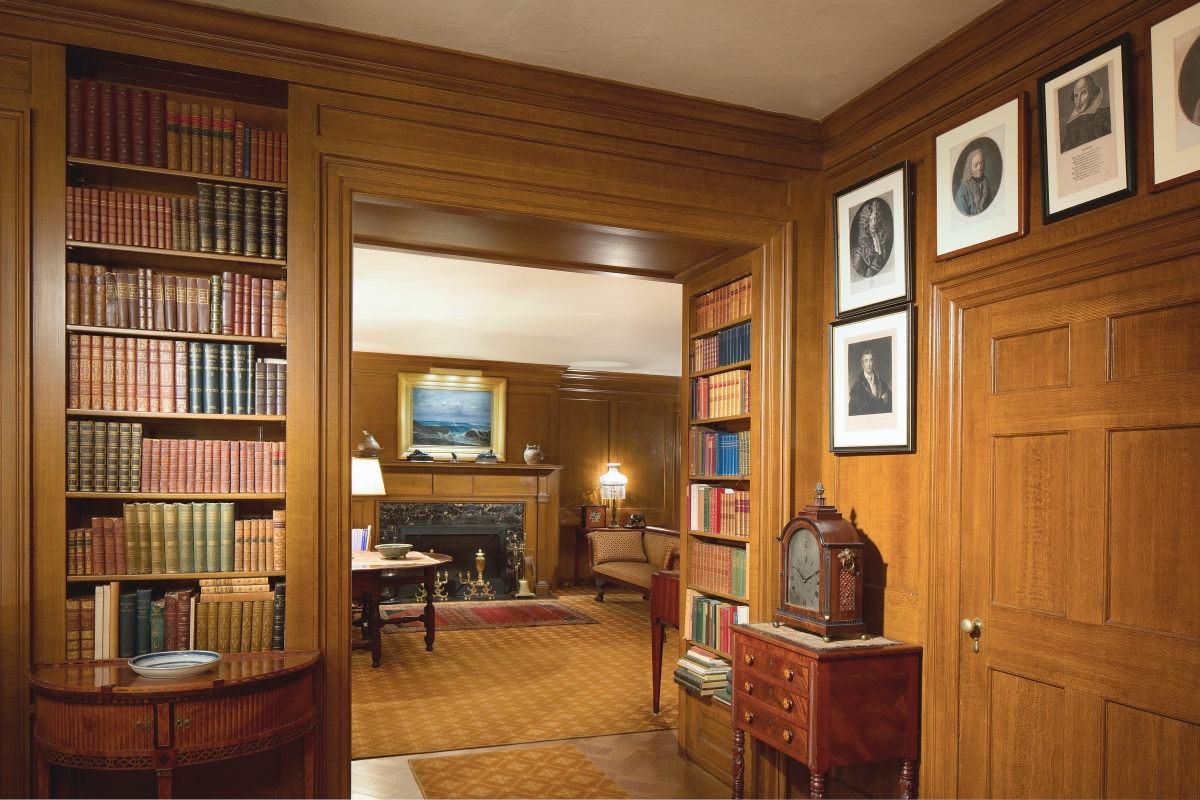 A view of the paneled environs within Hill-Stead reveal antiquarian bindings, horological specimes and more.