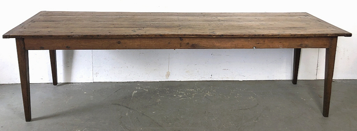 A Nineteenth Century farmhouse table with breadboard ends, an ample 107½ inches long, shot past its $600/900 expectation to settle at $5,625.