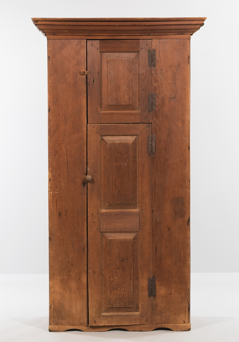 At $11,875, nearly three times the estimate, an Eighteenth Century pine cupboard with two paneled doors and hinges that were probably original, was one of the pieces with a mellow, original, weathered patina. Just over 6½ feet tall, it probably originated in New Hampshire.