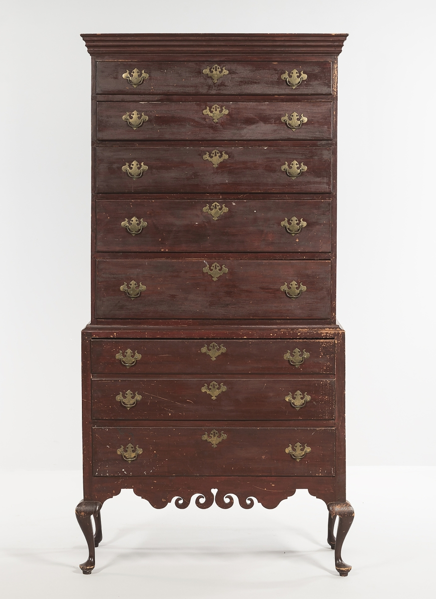 """Bringing $25,000, this circa 1780-1800 Dunlap chest-on-chest had a flat molded cornice above five graduated drawers, and the lower section had two drawers. Attributed to Samuel Dunlap, the cabriole legs ended in pad feet and it had a heart scroll valance, typical of the Dunlap school. It was cataloged """"with minor imperfections."""""""