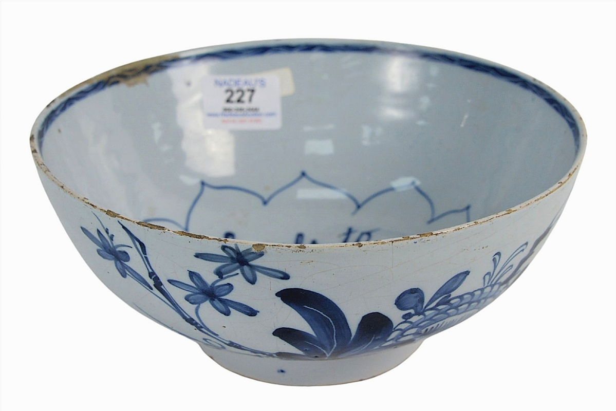 """A historic home in Newport, R.I., that was in the same family since 1761 contributed this Eighteenth Century Delft bowl whose interior was marked """"Success to British Arms in America."""" With a small rim repair, the bowl brought an exceedingly successful price of $24,600."""