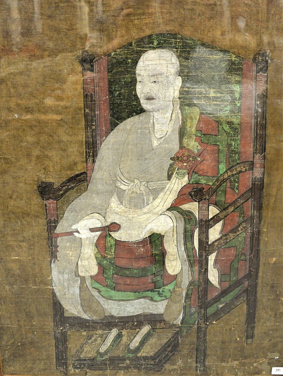 """Top lot in the sale was this large, framed and rare Sino-Korean monastic portrait of """"Yuan Chiao Kuo Shih Chih Hsiang,"""" ink and oil on silk, circa Fourteenth/Fifteenth Centuries or later. With great provenance, including the collection of Ralph Chait, the portrait of the revered Buddhist patriarch and leader, soared to $113,775."""