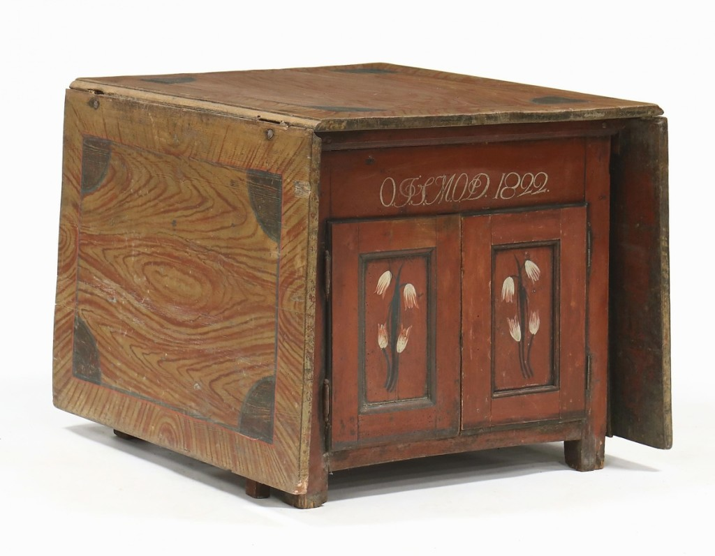 A buyer in North Carolina paid $2,520 for this Scandinavian painted cabinet that converted into a table by raising the two faux-grained drop leaves. It was one of just a few pieces of Scandinavian furniture in the sale.