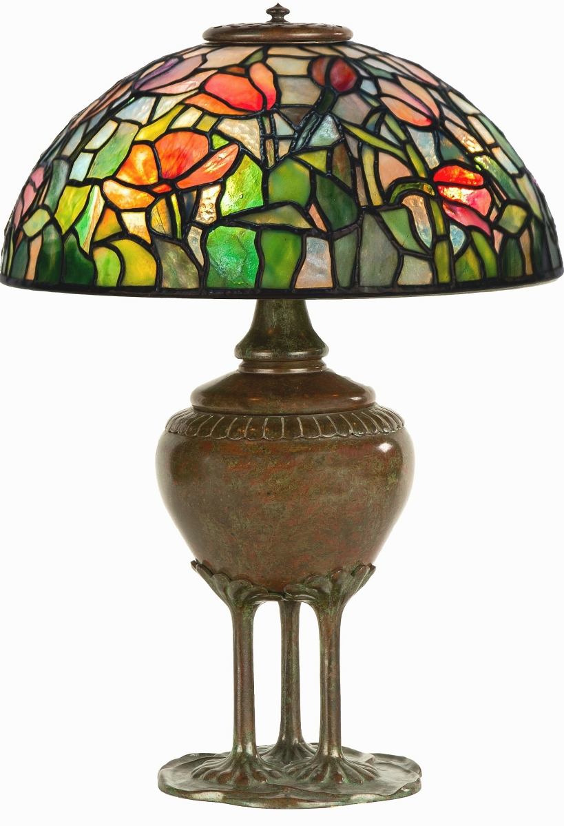 Fetching $42,000, this rare Tiffany Studios New York Tulip table lamp featured a 14-inch shade on a 20-inch-high bulbous base that had a reddish-green patina.