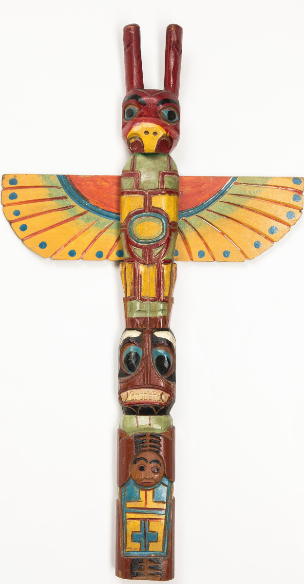 "Selling for $5,720 was this Northwest Coast totem pole. It dated to circa 1900, measured 35½ inches high, and was signed ""George"" to the back."