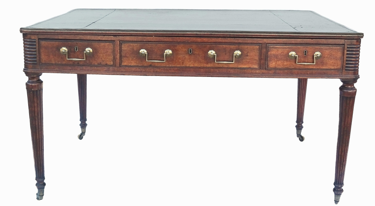 Taking $12,800 was this Regency mahogany writing table with green tooled leather top and tapered, reeded legs.