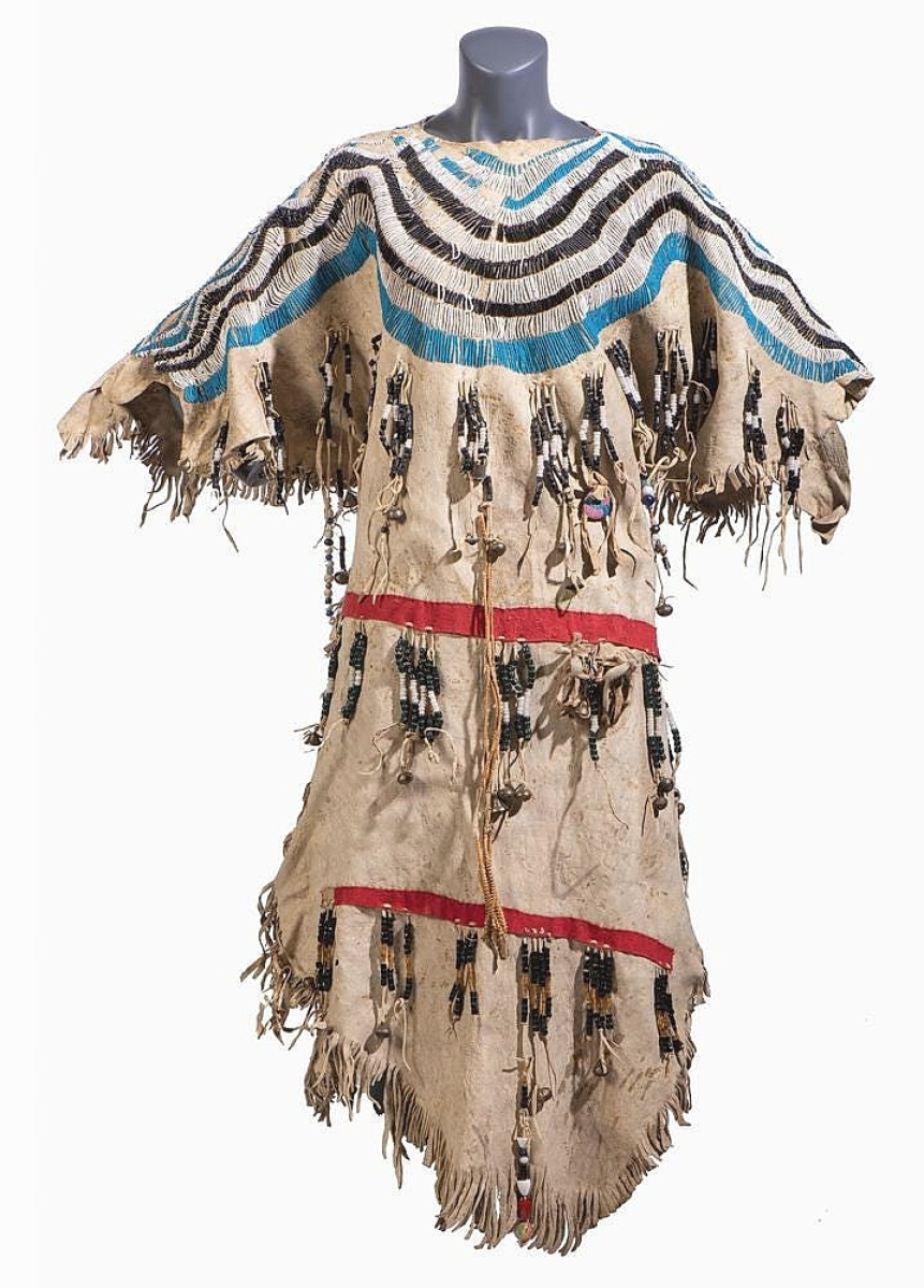 A Blackfeet beaded hide dress came from descendents of US Special Agent Johnson N. High. Following his service in the Civil War, High was appointed to oversee the Bannock and Shoshone Indians on the Fort Hall Reservation in Idaho Territory. The dress was beaded with numerous colors and charms and went on to bring $20,000.