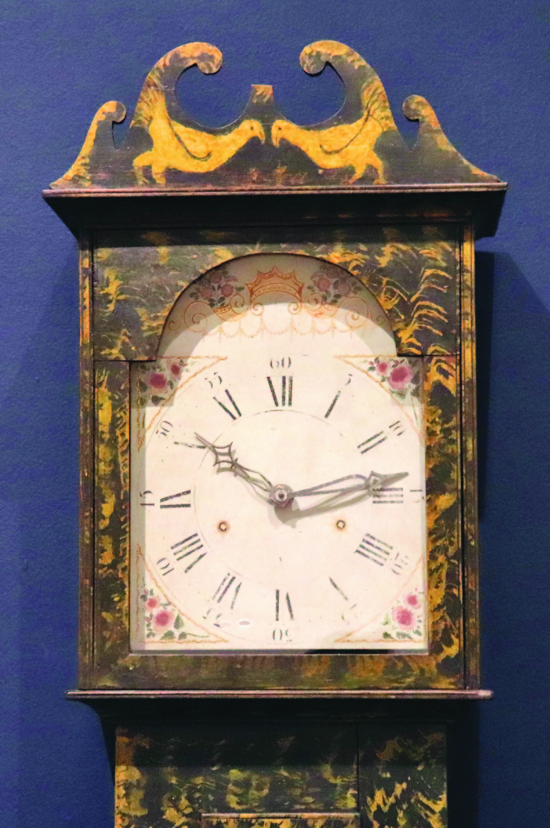 Tall case clock with birds (aka Chicken Clock), possibly Washington County, circa 1820. Poplar with chrome yellow and black paint, clock movement by Asa Hopkins, Litchfield, Conn.