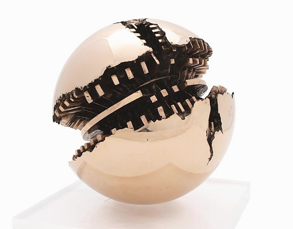 """A phone bidder from Ireland beat out four competing phone bidders, all from Italy, to take """"Sfera"""" by Arnaldo Pomodoro (Italian, b 1926) to $181,500, the top price in the sale ($80/120,000)."""