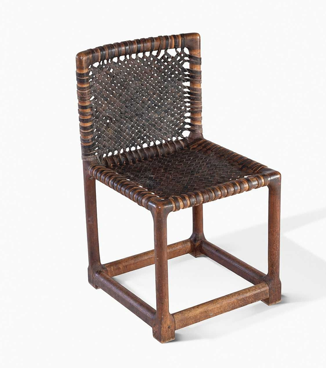 Wharton Esherick, Hessian Hills Child's Chair, 1931. Red oak and leather. In 1924, Wharton Esherick created a prototype for a child's chair, now in the permanent collection of the Wharton Esherick Museum, of which he would make six the following year. These chairs were made in lieu of tuition payment for his then 9-year-old daughter, Mary, to accompany her to the newly minted progressive school for children in Croton, N.Y., known as the Hessian Hills School. In the fall of 1930, the school suffered a fire that took with it the chairs Esherick delivered in 1925. Funded by insurance money, Esherick made 15 replacement chairs in 1931. This is one of three 1931 Hessian Hill chairs known to exist. Two others are in the collection of the Modernism Museum Mount Dora. Moderne Gallery.