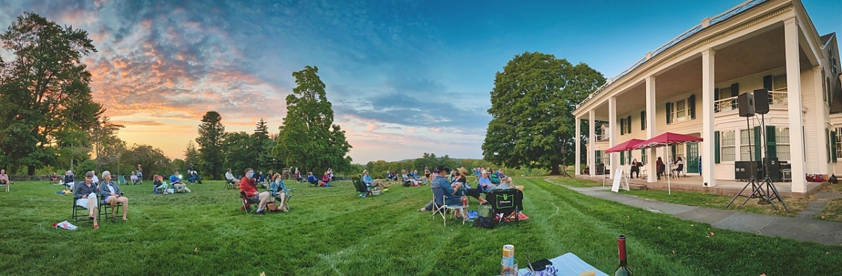 """A sunset lingered over Hill-Stead during an act from the museum's """"From the Porch"""" performing arts series."""
