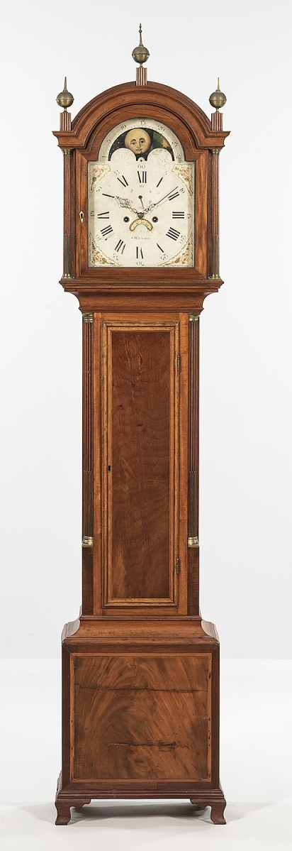 Simon Willard produced this tall case clock with mahogany veneer and satinwood banding on the case. It dated to 1795 and sold for $18,750.