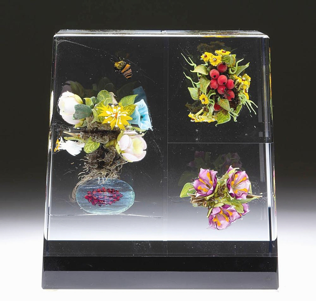 Topping works by a contemporary paperweight maker was Paul Stankard's botanical assemblage lampwork studio art glass paperweight sculpture featuring encased blocks of blossoms. It achieved $9,360 ($6/8,000).