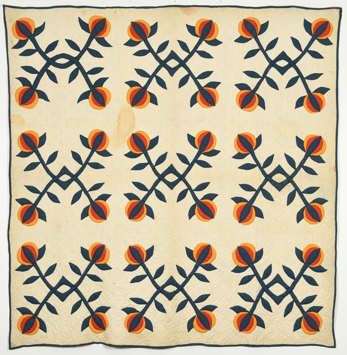 Pomegranate pattern quilt by Isabella (Bell) Phillips Boyd (1862-1953), late 1800s. Cotton, 78½ by 76¼ inches. Gift of Dr Paul M. Goggans.