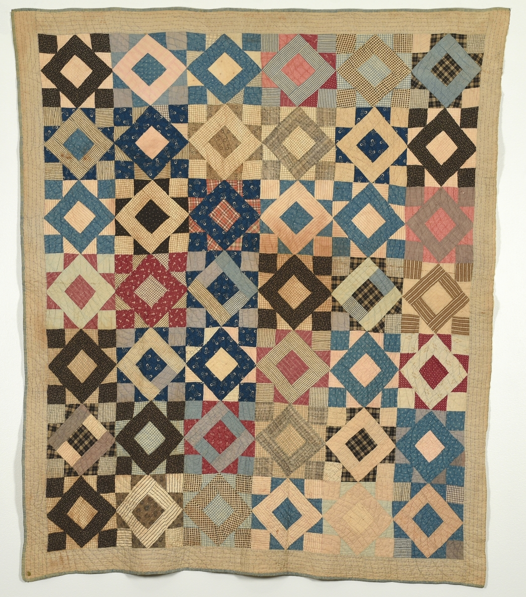 Triangle Square quilt by Beatrice Virginia Elizabeth Jenkins Phillips (1864-1942), late 1800s. Cotton, 78½ by 70 inches. Gift of Dr Paul M. Goggans.