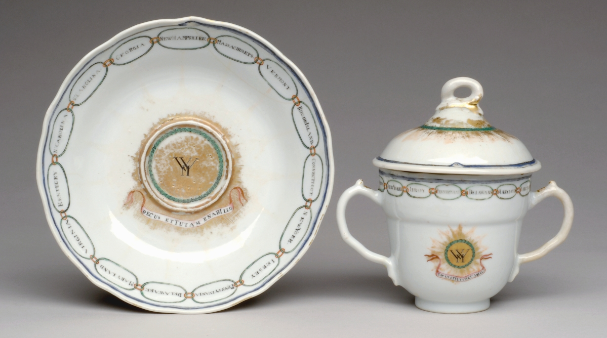 Saucer and caudle cup with cover from a service for George Washington (President 1789-1797), 1796, designed by Andreas Everardus van Braam Houckgeest (Dutch, 1739-1801). Porcelain with enamel, gilt and underglaze blue decoration. Gift of the McNeil Americana Collection, 2006. Image courtesy of Philadelphia Museum of Art, 2021.