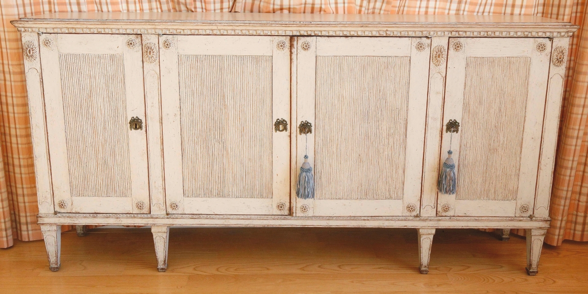 A white-washed finish augmented this Nineteenth Century Continental sideboard, which brought the sale's top price of $21,250 from a private collector bidding online ($400/600).