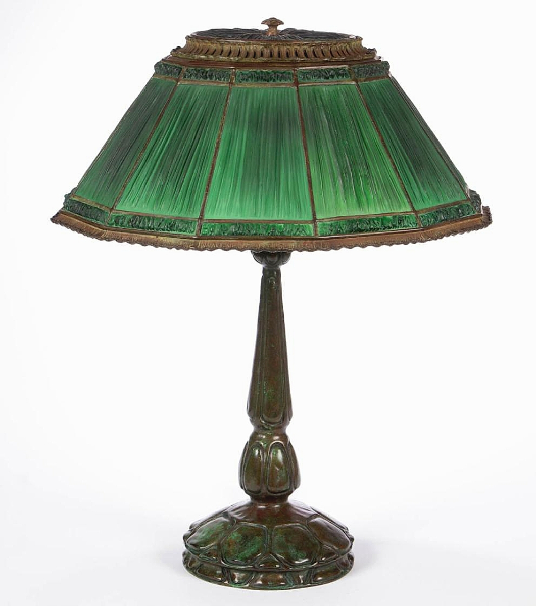 Let there be light! This Tiffany Studios linenfold and turtleback art glass electric table lamp, in undamaged original condition, realized the brightest price as it brought $21,060 from an East Coast collector bidding on the phone ($10/15,000).