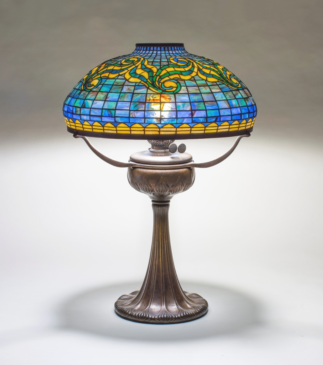 Tiffany Studios is a perennial favorite with collectors, and Lillian Nassau, LLC, had plenty of examples to chose from as the firm sold a nautical calendar frame and an engraved Favrile glass center bowl. Still available for any potential Tiffany collector to purchase was this early Tyler table lamp, circa 1902-03, which had its original signed shade and base. New York City.
