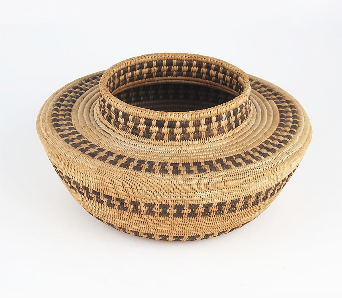 Marcy Burns noted the fine weave, pleasing shape, excellent condition and beautiful patina of this Mono bottleneck basket, which was coiled out of sedge and bracken fern root on a grass foundation and dated to the first quarter of the Twentieth Century. It was still available with Marcy Burns American Indian Arts, LLC, New York City.