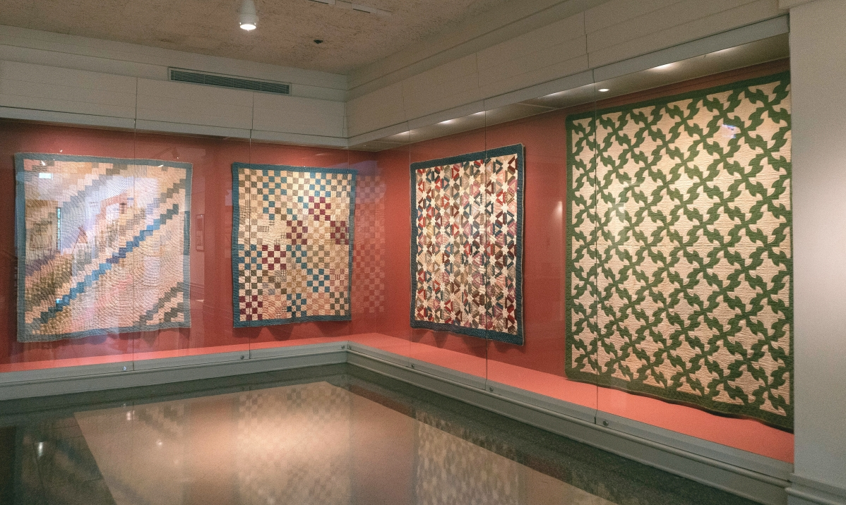 """Installation image, """"Quilts From The Goggans Family Of The Chattahoochee Valley."""" Part I of the exhibition is on through December 5."""