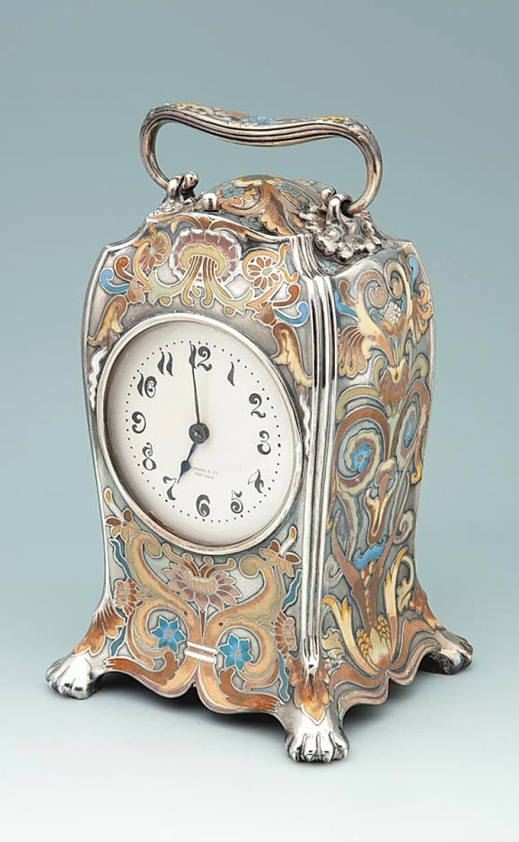"""Available with S.J. Shrubsole, Corp., was this American silver and polychrome enamel mantel clock, made by Tiffany & Co., circa 1885. The enameling on the clock is reminiscent of the decoration on Tiffany's """"Orchid"""" vase, which was the company's most important silver showpiece during the 1889 Paris Exposition. New York City."""