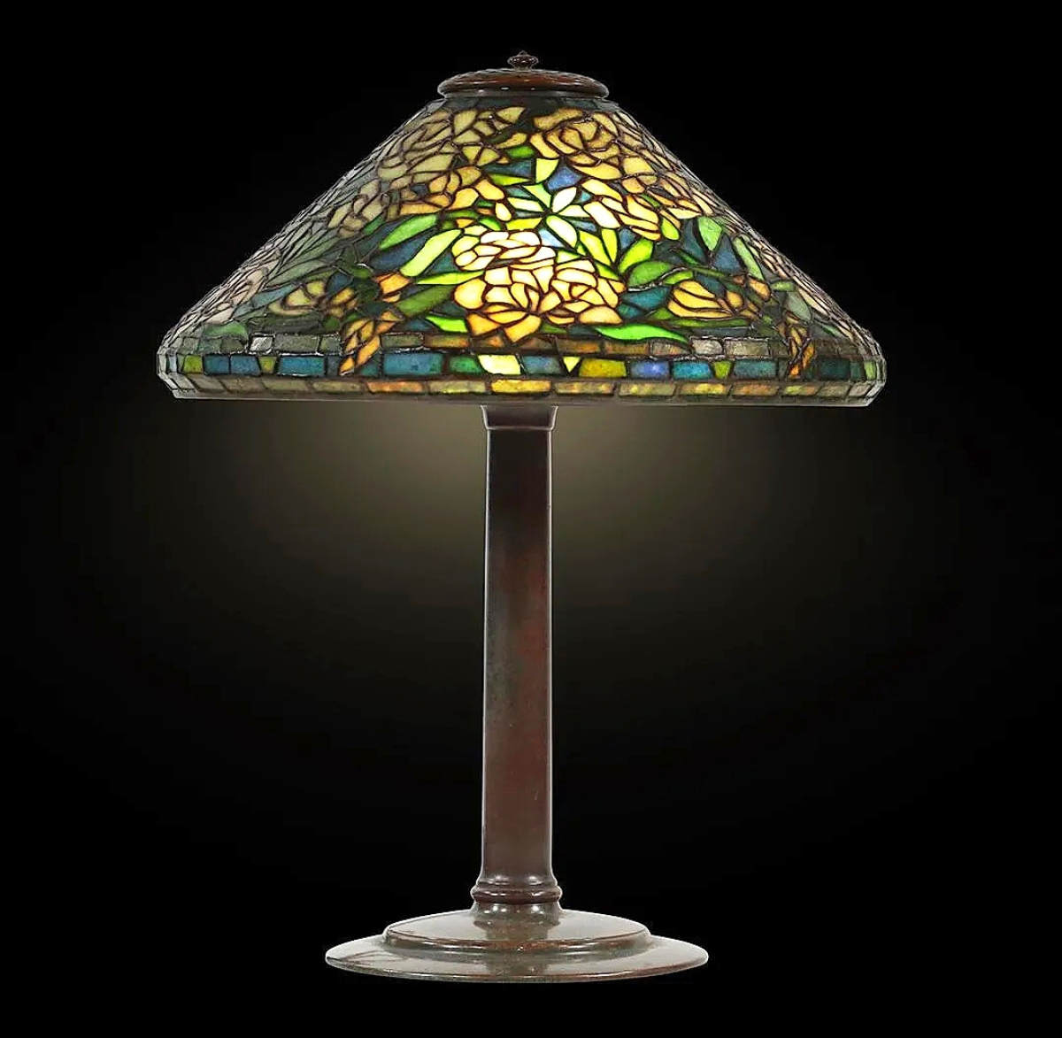 """At $12,000 was a Tiffany Studios """"Wild Rose"""" leaded glass table lamp on bronze base. It was the top lot of the 1,000-lot sale."""
