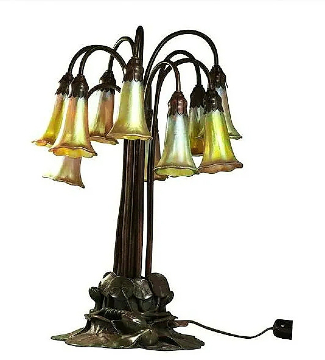 Tiffany Studios collectors were drawn to a 10-light Lily lamp with signed favrile shades and bronze base that took $10,625.