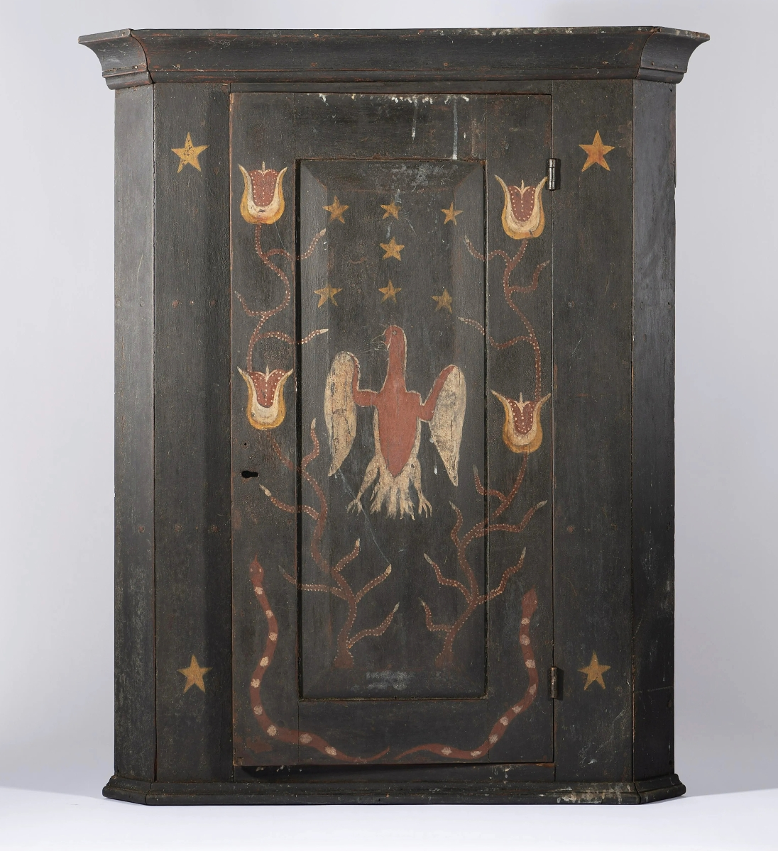 At $5,535 was this Tennessee painted hanging corner cupboard featuring decorations of a tulip, eagle, snakes and stars. It was once in the collection of Dr Mervyn King.